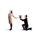 Woman rejecting man young beautiful women men with flowers isolated on white background Stock Photography