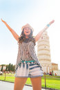 Woman rejoicing in front of leaning tower of pisa happy young tuscany italy Stock Image
