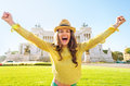 Woman rejoicing on piazza venezia in rome italy portrait of happy young Stock Photos