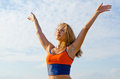 Woman rejoicing in the sunshine Royalty Free Stock Image