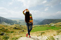 Woman relax and travel in mountai village with picturesque view long hair hat mountain montenegro durmitor Royalty Free Stock Image