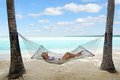 Woman relax during travel vacation on tropical island happy relaxing hammock the beach in aitutaki lagoon cook islands Royalty Free Stock Photography