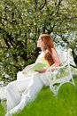 Woman relax under blossom tree in summer Stock Image