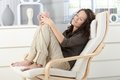 Woman relaxing in armchair Royalty Free Stock Photo