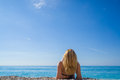 Woman relaxing on the beach in Greece Royalty Free Stock Photo