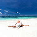 Woman relaxing on beach tropical Royalty Free Stock Image