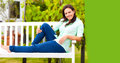 Woman is relaxing on a bench in the nature in the right corner you can put your text Stock Images