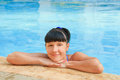 Woman relaxing in a blue pool young Royalty Free Stock Photography
