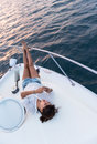 Woman relaxing on a boat beautiful enjoying the summer Stock Photos