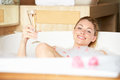 Woman relaxing in bubble bath smiling Stock Photos