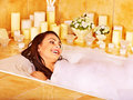 Woman relaxing at bubble bath water in Royalty Free Stock Images