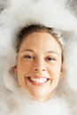 Woman Relaxing In Bubble Filled Bath Royalty Free Stock Photography