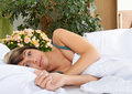 Woman relaxing in cosy bed Royalty Free Stock Photo