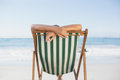 Woman relaxing in deck chair on the beach a sunny day Royalty Free Stock Photo
