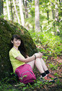Woman relaxing in the forest in a spring day Royalty Free Stock Images