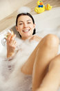 Woman Relaxing With Glass Of Wine In Bath Stock Images