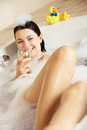 Woman Relaxing With Glass Of Wine In Bath Royalty Free Stock Images