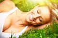 Woman relaxing on grass. Royalty Free Stock Photo