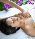 Woman relaxing while having spa treatment Stock Photos