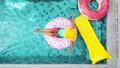 Woman relaxing on inflatable ring in pool Royalty Free Stock Photo
