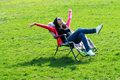Woman relaxing on lounger beautiful brunette in the spring grass Royalty Free Stock Image