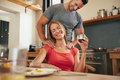 Woman relaxing while man massaging her shoulders happy young women sitting at breakfast tablet holding cup of coffee getting a Stock Images