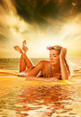 Woman relaxing near the sea Stock Photos