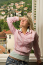 Woman relaxing near the window Stock Photos