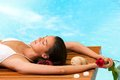 Woman relaxing next to swimming pool portrait of attractive in spa Stock Photo
