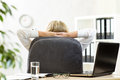 Woman relaxing in office sitting back in chair Royalty Free Stock Photo