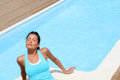 Woman relaxing by pool Royalty Free Stock Photo