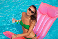 Woman relaxing in a pool portrait of smiling young swimsuit on inflatable mattress Royalty Free Stock Photo