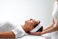 Woman relaxing at reiki session. Royalty Free Stock Photo