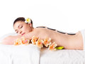 Woman relaxing in spa salon with hot stones adult beautiful on back Stock Photo