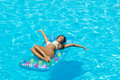 Woman relaxing at the swimming pool Royalty Free Stock Photography