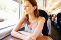 Woman relaxing on train journey looking off camera Royalty Free Stock Photo