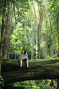 Woman relaxing in a tropical forest Royalty Free Stock Photo