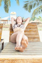 Woman relaxing in tropical resort young on beach chair and Stock Photos