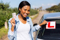 Woman removing sign african learner driver after getting her driving license Stock Images