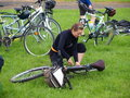 Woman repairing her bike, Lublin, Poland Royalty Free Stock Photography