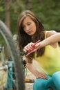 Woman repairs a bike Royalty Free Stock Photo