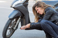 Woman repairs scooter Royalty Free Stock Photo