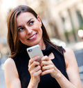 Woman replying a text message Stock Photo