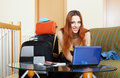 Woman reserving hotel online in the internet using laptop at home Royalty Free Stock Photography