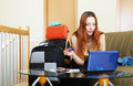 Woman reserving resort online in the internet using laptop Royalty Free Stock Photos