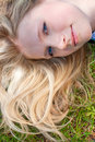 Woman rest on the grass Royalty Free Stock Image
