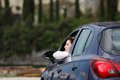 Woman resting in the car Royalty Free Stock Photo