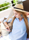 Woman resting on a deckchair using smart phone Royalty Free Stock Photo