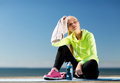 Woman resting after doing sports outdoors sport and lifestyle concept Royalty Free Stock Images