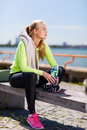 Woman resting after doing sports outdoors sport and lifestyle concept Stock Image